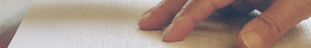 Hand running across a braille document